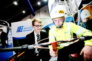 Apprentice working on a cable at Skills NI