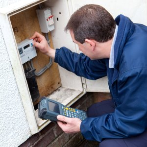 A member of the NIE team reading an outdoor credit meter